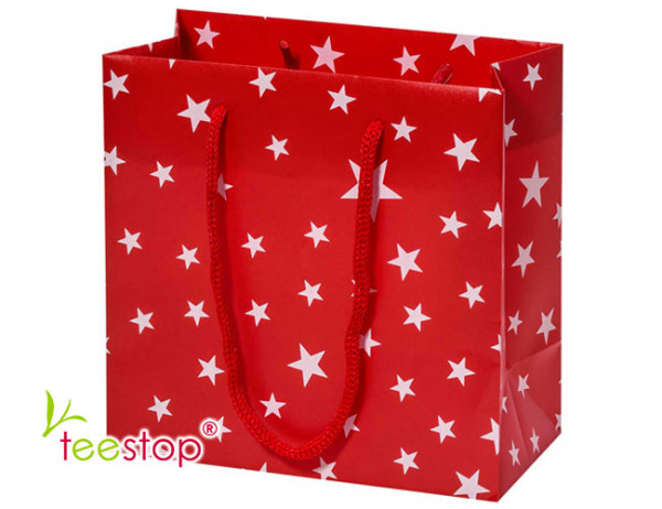 rote Geschenktragetasche mit weißen Sternen zum Befüllen